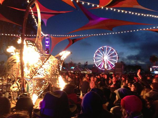 Chilly concert-goers huddle around the hot star for warmth.