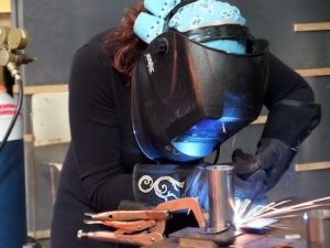 Sabrina on the welder